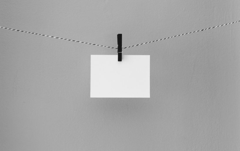 Blank card lie on a rope